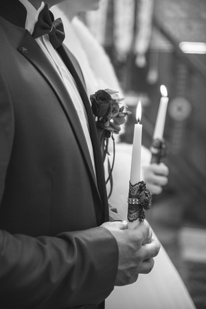 Photo for Wedding ceremony in church, young married couple holding candles, christian traditions - Royalty Free Image