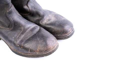 Foto de Retro boots - Kirza boots on white background, used in Soviet Union for soldiers in the army and for work, made of artificial leather - Imagen libre de derechos