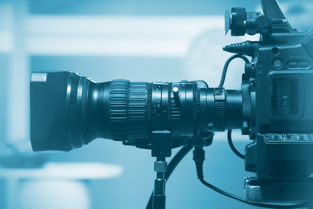 Photo for Professional video camera lens, recording TV show in studio - Royalty Free Image