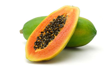 Photo for Half cut and whole papaya fruits on white background - Royalty Free Image