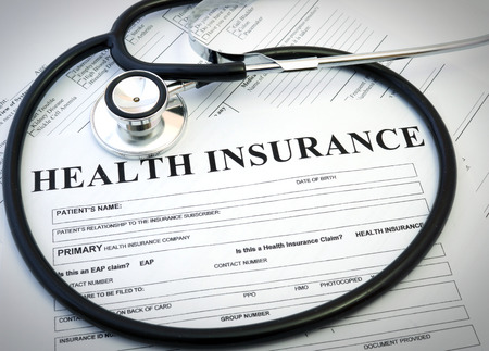 Foto de Health insurance form with stethoscope concept - Imagen libre de derechos