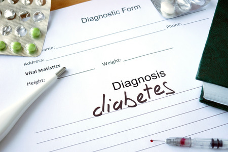 Photo for Diagnostic form with Diagnosis diabetes and pills. - Royalty Free Image