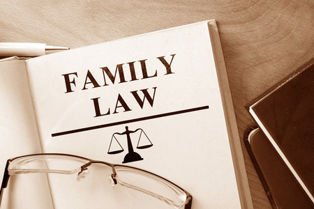 Photo for Book with words family law and glasses. - Royalty Free Image