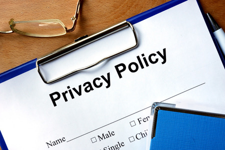 Photo pour Privacy policy form on a wooden table and pen. - image libre de droit