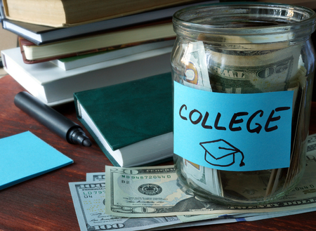 Photo pour Jar with label college and money on the table. - image libre de droit