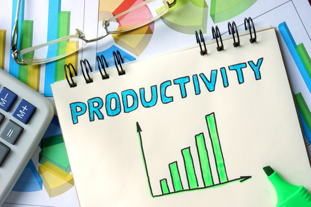 Foto de Productivity  concept. Notepad on the table. - Imagen libre de derechos