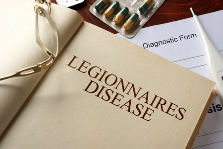 Foto per Book with diagnosis legionnaires disease. Medic concept. - Immagine Royalty Free