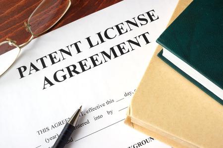 Photo pour Patent License agreement on a table. Copyright concept. - image libre de droit