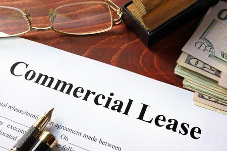 Foto de Commercial Lease agreement with money on a table. - Imagen libre de derechos