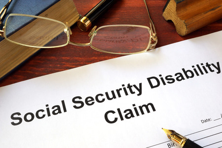 Photo pour Social security disability claim on a wooden table. - image libre de droit