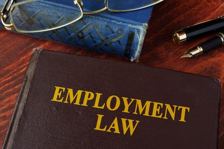 Foto de Book with title employment law on a table. - Imagen libre de derechos