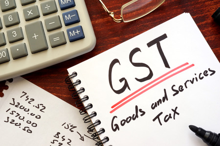 Photo for The goods and services tax  (GST) written in a note. - Royalty Free Image