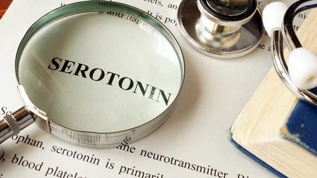 Foto de Serotonin written on a page. Human hormones. - Imagen libre de derechos