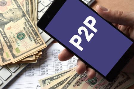 Photo for Smartphone in hand with message P2P. Peer to peer lending concept. - Royalty Free Image
