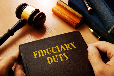 Photo for Hands holding Fiduciary duty in an court. - Royalty Free Image