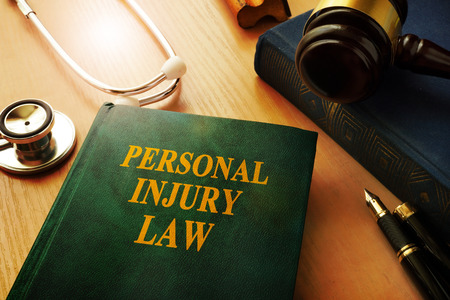 Photo for Personal injury law book on a table. - Royalty Free Image