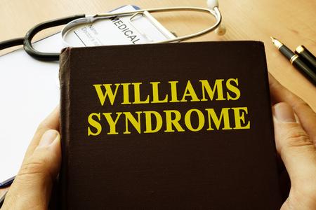 Foto de Book with title Williams Syndrome on a table. - Imagen libre de derechos