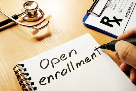 Photo for Open enrollment written on a note and medical stethoscope. - Royalty Free Image