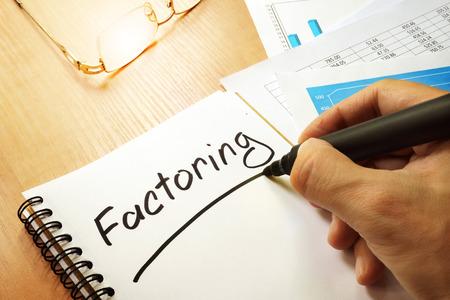 Photo pour Factoring written by hand in a note. - image libre de droit