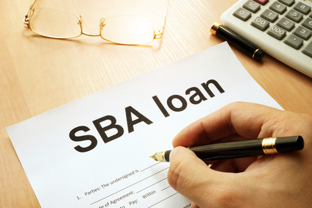 Photo pour SBA loan form on a table. - image libre de droit