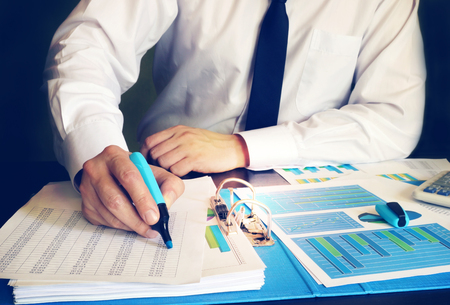 Photo for Businessman checking accounting data in an office. - Royalty Free Image