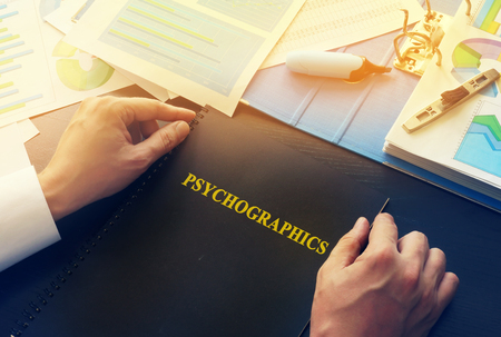 Photo for Manager taking book with name psychographics. - Royalty Free Image