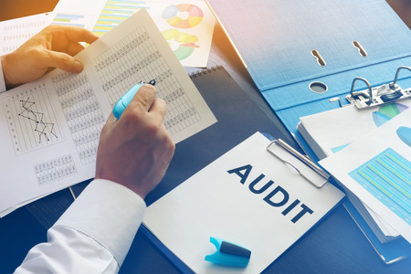 Photo for Document with title Audit on an office table. - Royalty Free Image