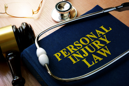 Photo pour Personal Injury Law concept. Book and stethoscope. - image libre de droit