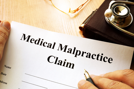 Photo for Medical Malpractice Claim on a table. - Royalty Free Image