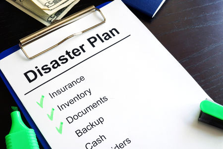 Foto de Disaster Plan on a table. - Imagen libre de derechos