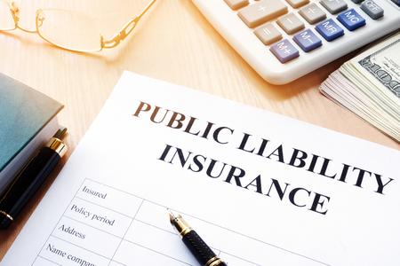 Photo pour Public liability insurance policy on an office desk. - image libre de droit