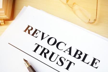 Photo pour Revocable trust on a wooden desk. - image libre de droit