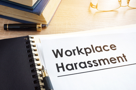 Photo pour Documents about workplace harassment in an office. - image libre de droit