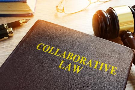 Foto de Collaborative Law or collaborative practice, divorce or family law on a desk. - Imagen libre de derechos