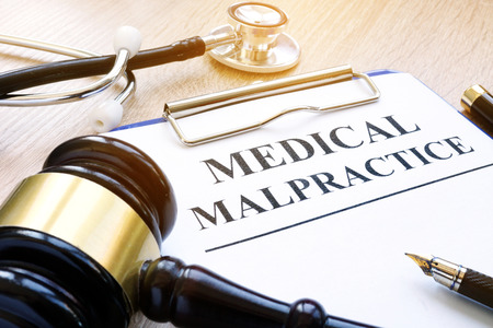 Photo for Clipboard with documents about medical malpractice and gavel. - Royalty Free Image