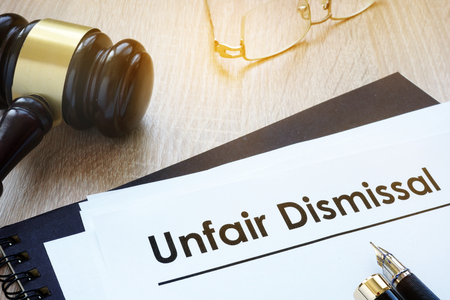 Photo for Documents unfair dismissal and gavel in a court. - Royalty Free Image