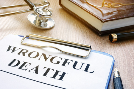 Photo pour Wrongful death form and stethoscope on a table. - image libre de droit