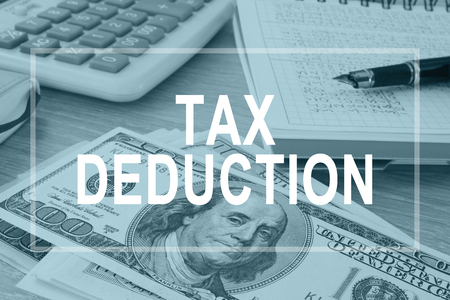 Photo pour Tax deductions. Office table with financial report. - image libre de droit
