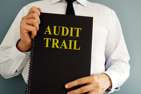 Photo for Audit trail concept. Auditor holding book. - Royalty Free Image