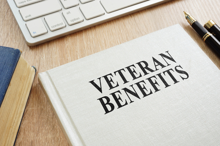 Foto de Book about Veteran Benefits on a desk. - Imagen libre de derechos