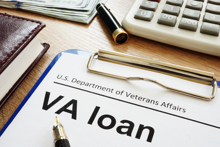 Photo pour VA loan U.S. Department of Veterans Affairs form with clipboard. - image libre de droit