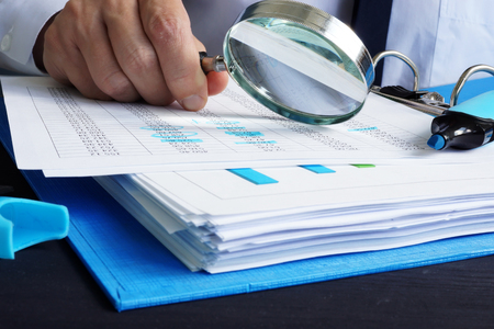 Photo for Auditor is working with financial documents. Audit or assessments. - Royalty Free Image