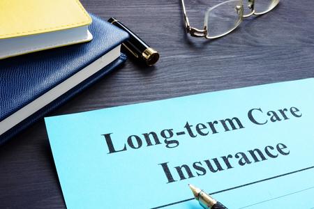 Photo pour Long term Care Insurance policy on a table. - image libre de droit