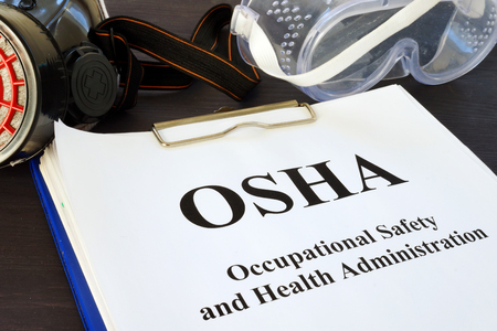 Photo pour Pile of documents with Occupational Safety and Health Administration OSHA. - image libre de droit