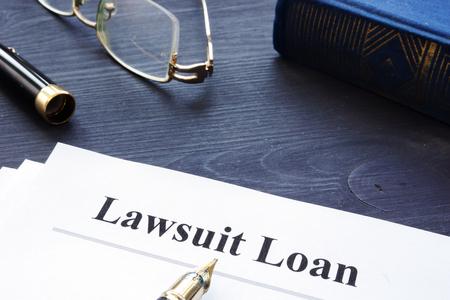 Foto de Lawsuit Loan form on a wooden desk. - Imagen libre de derechos