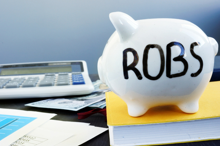 Photo for Rollover for Business Startups ROBS written on a piggy bank. - Royalty Free Image