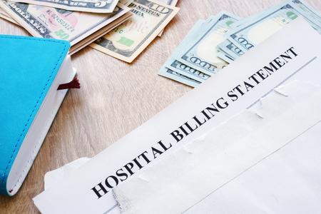 Foto de Hospital billing statement in the envelope. Medical debt. - Imagen libre de derechos