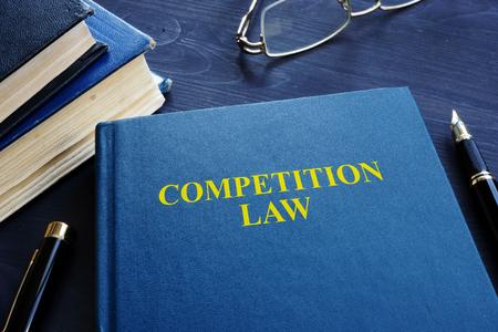 Foto de Competition law and pen on a table. - Imagen libre de derechos
