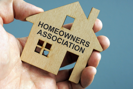 Photo pour Homeowners Association HOA written on a model of home. - image libre de droit