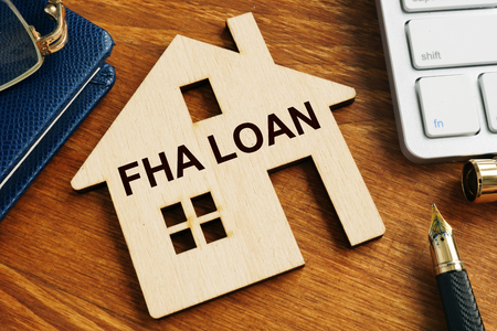 Photo for FHA loan written on the model of home. - Royalty Free Image
